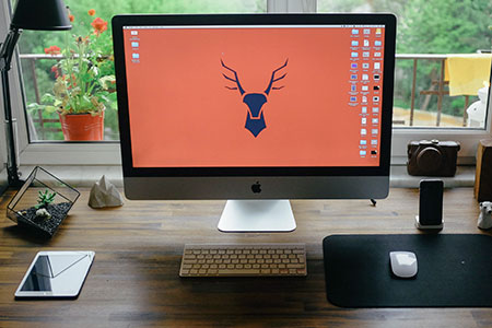 Graphic-designer-work-desk-with-iMac